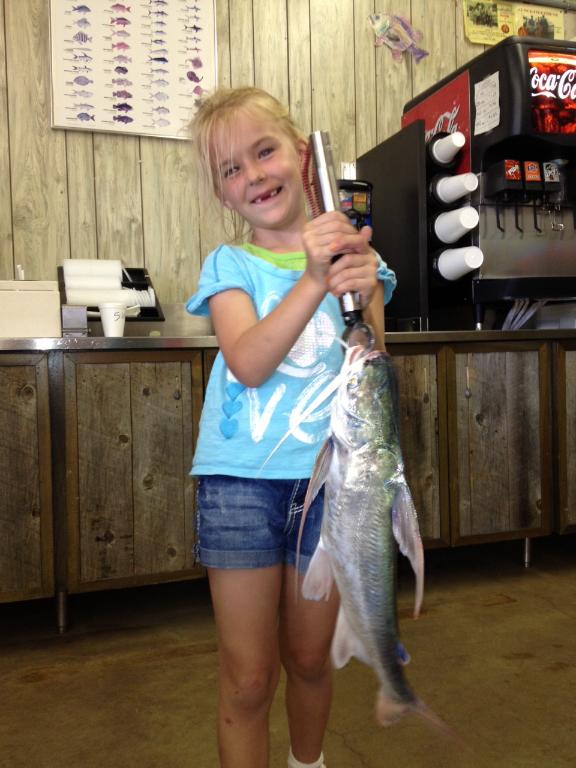 dakota-weighing-her-catch