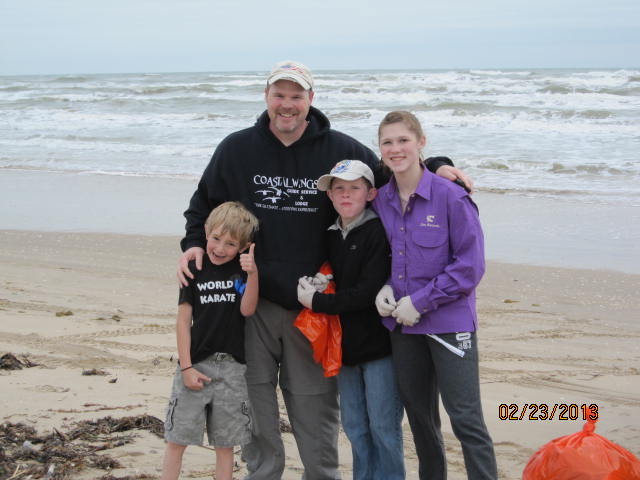 Johnny Rayburg, CCA SA President & kids at Billy Sandifer beach cleanup
