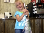dakota-weighing-her-catch